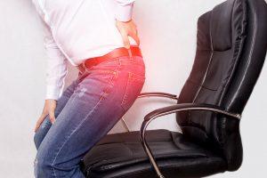 Beschwerden durch Sitzen im Büro - Eisenhauer Training ist die Lösung